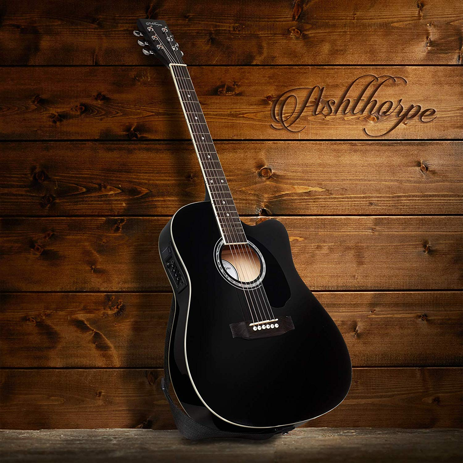 Ashthorpe Acoustic-Electric guitar on display in front of a wall of wood