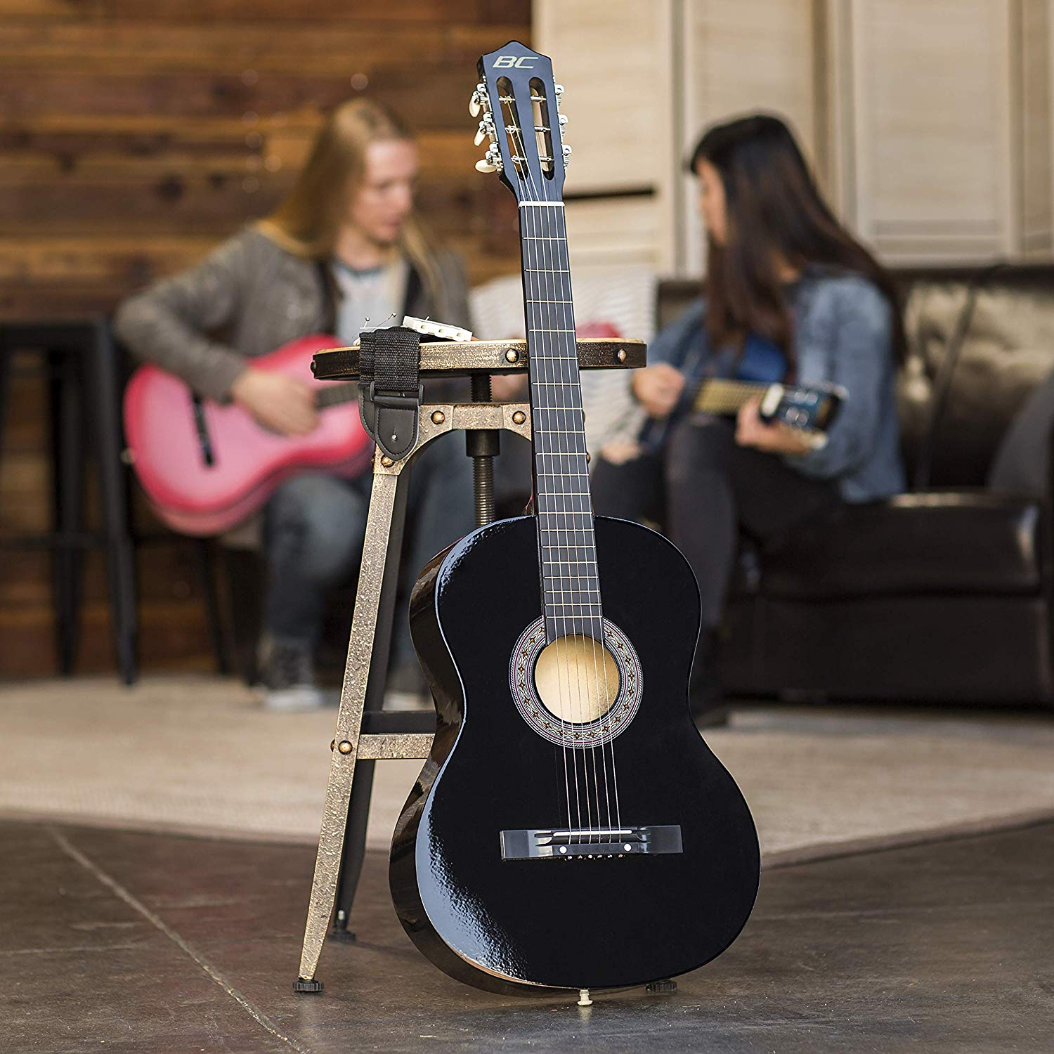 """Front side of the Best Choice 38"""" Acoustic Guitar while it is sitting on a guitar stand upright"""
