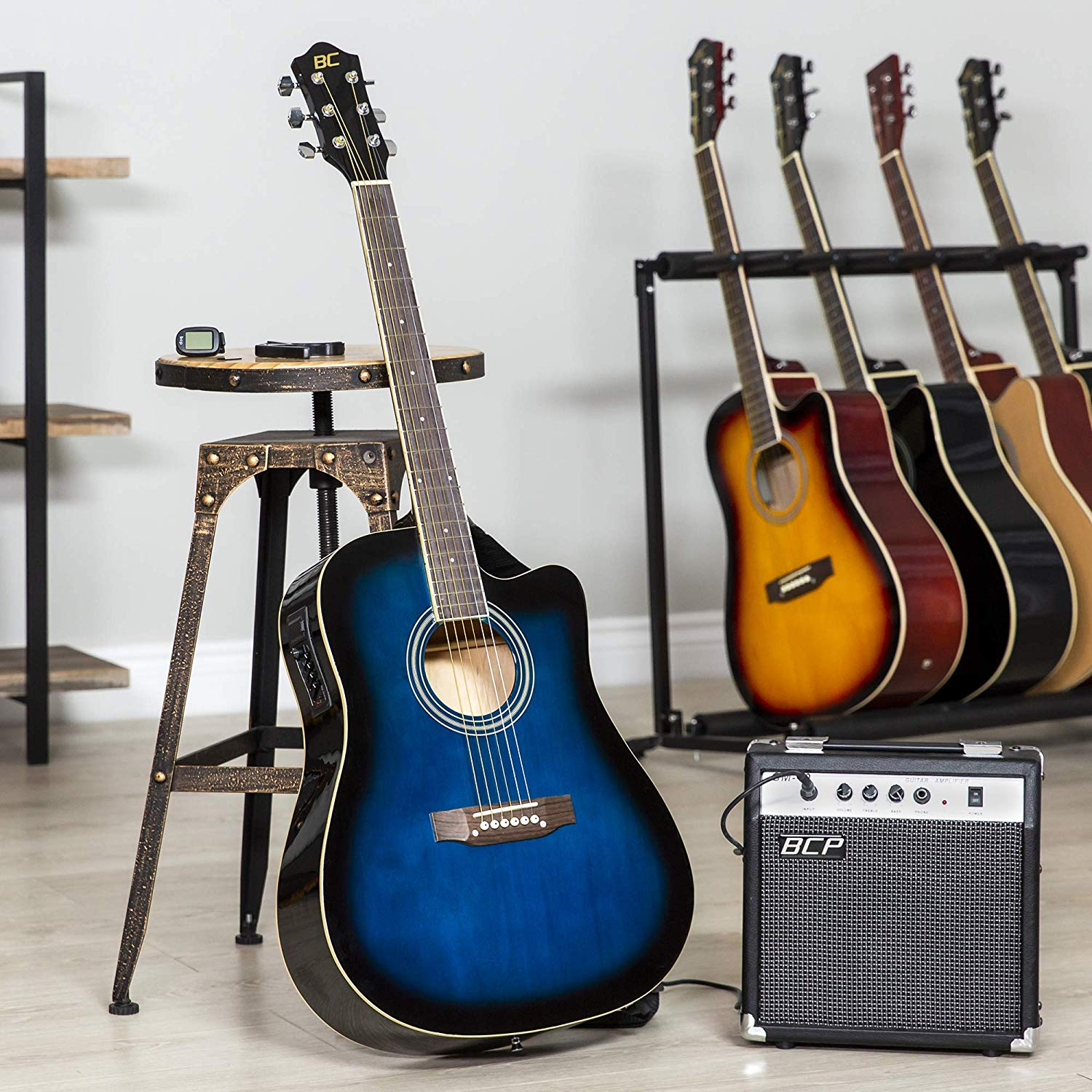 The Blue Colored BC Acoustic-Electric Guitar standing upright on display