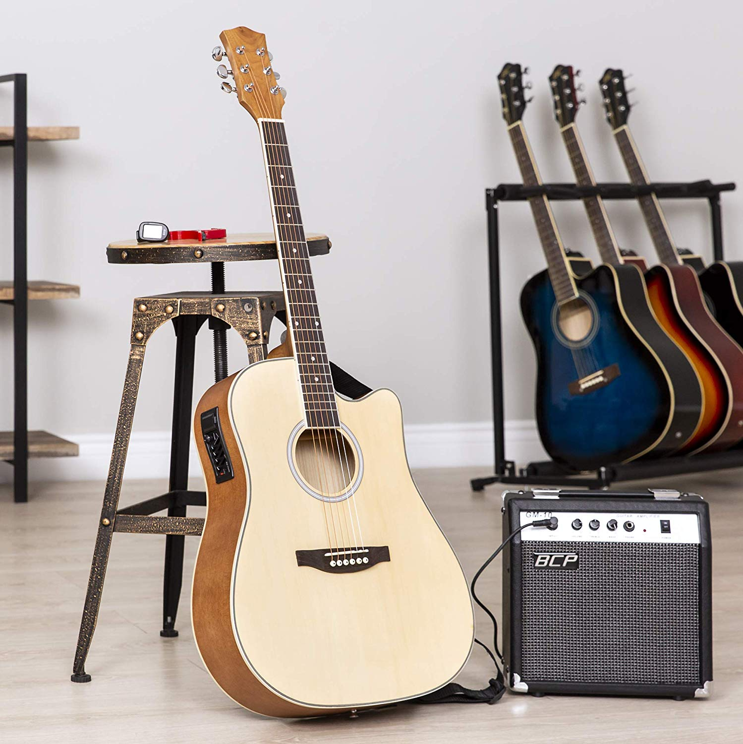 The Natural Colored BC Acoustic-Electric Guitar standing upright on display