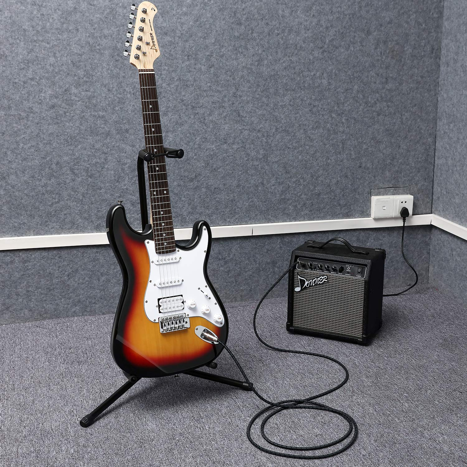 The Donner DST-1S Sunburst Electric Guitar and Amp that come with it