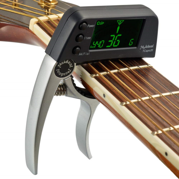 The Meideal 2 In 1 Guitar Capo & Tuner Clamped onta a guitar