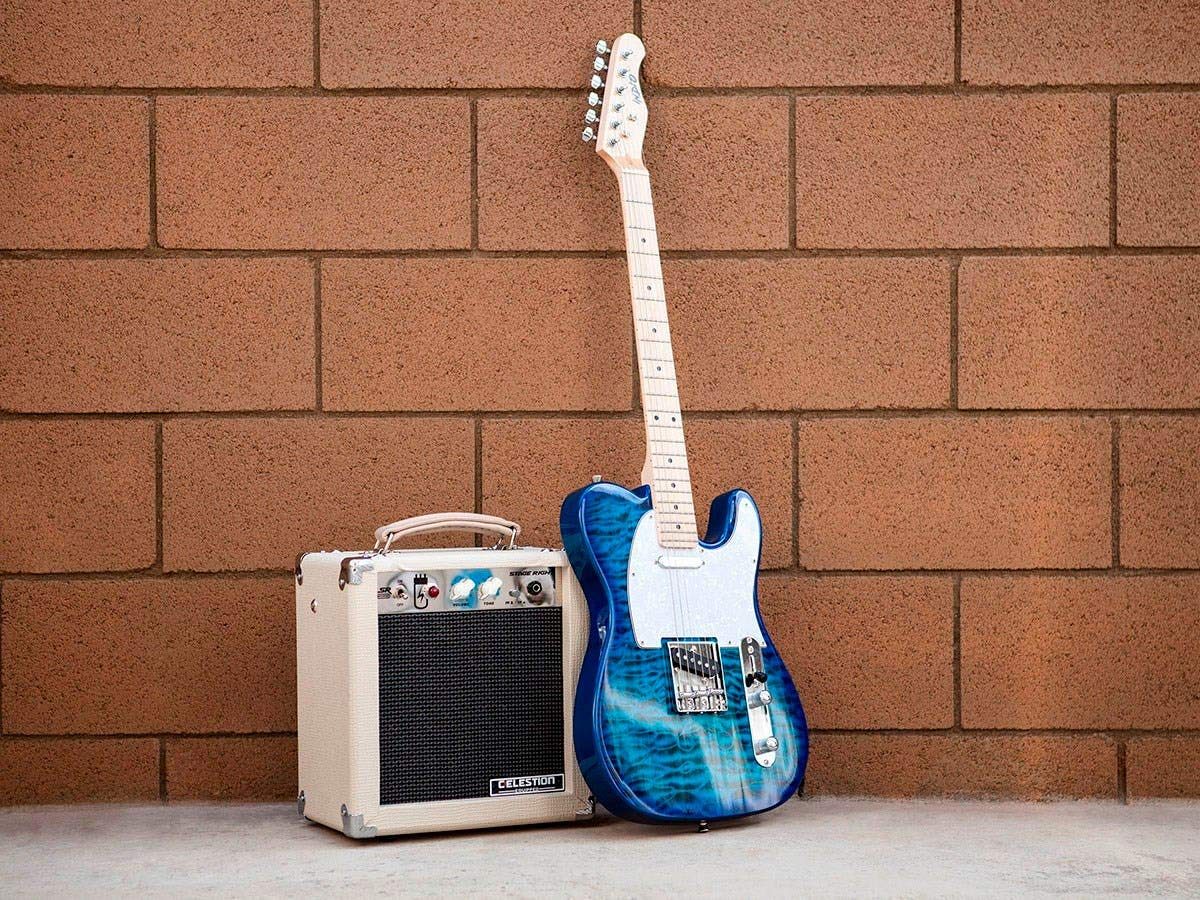 The Stage Right 5W Combo Tube Amplifier on Display next to a Guitar