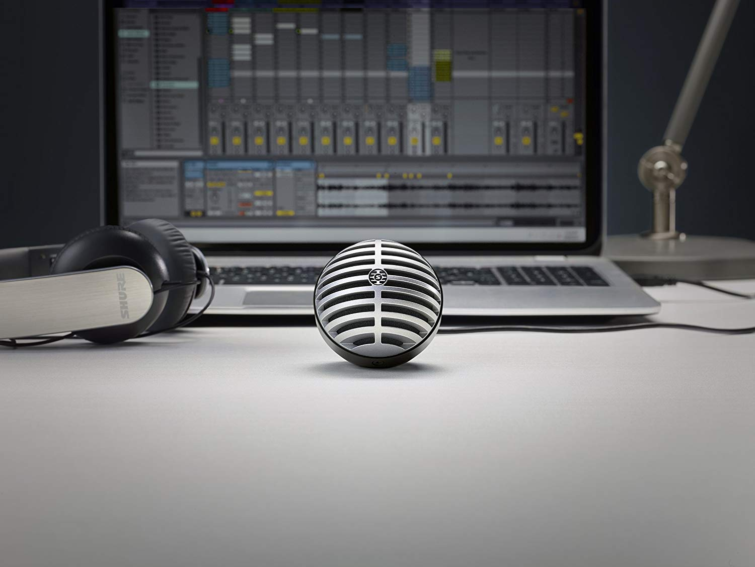 The Shure MV5 Digital Condenser Mic Sitting front and center in front of a Computer