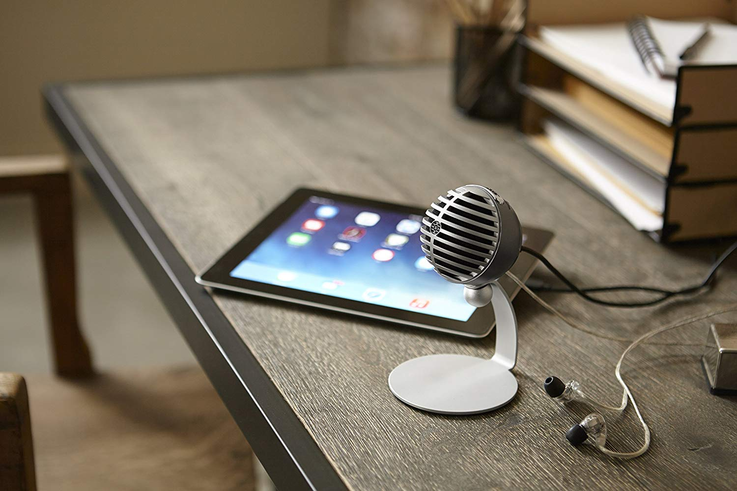 The Shure MV5 Digital Condenser Mic sitting on a desk