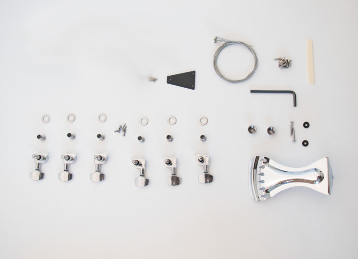 Closer View of the Contents that Come With The Resonator Acoustic Build Your Own Guitar Kit